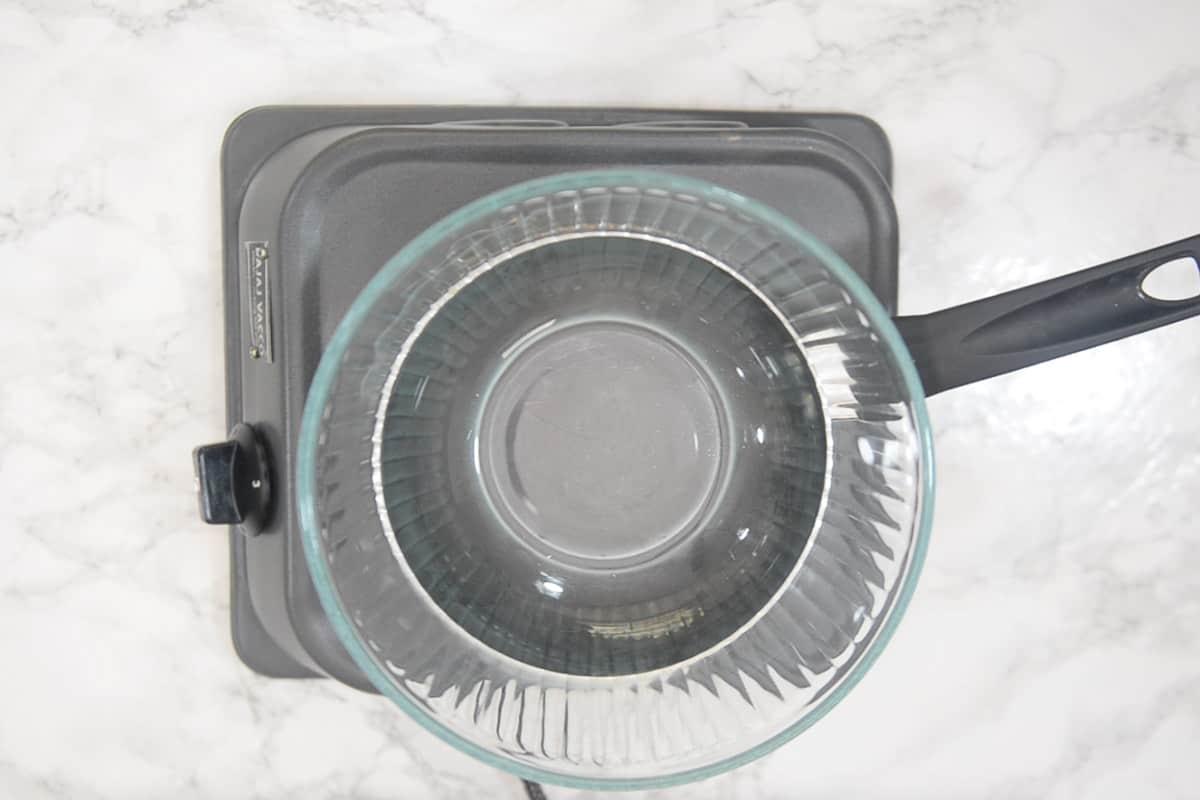 Heatproof bowl kept over simmering water.