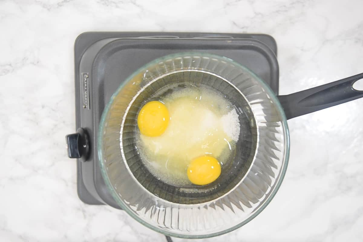 Sugar and eggs added in the bowl.