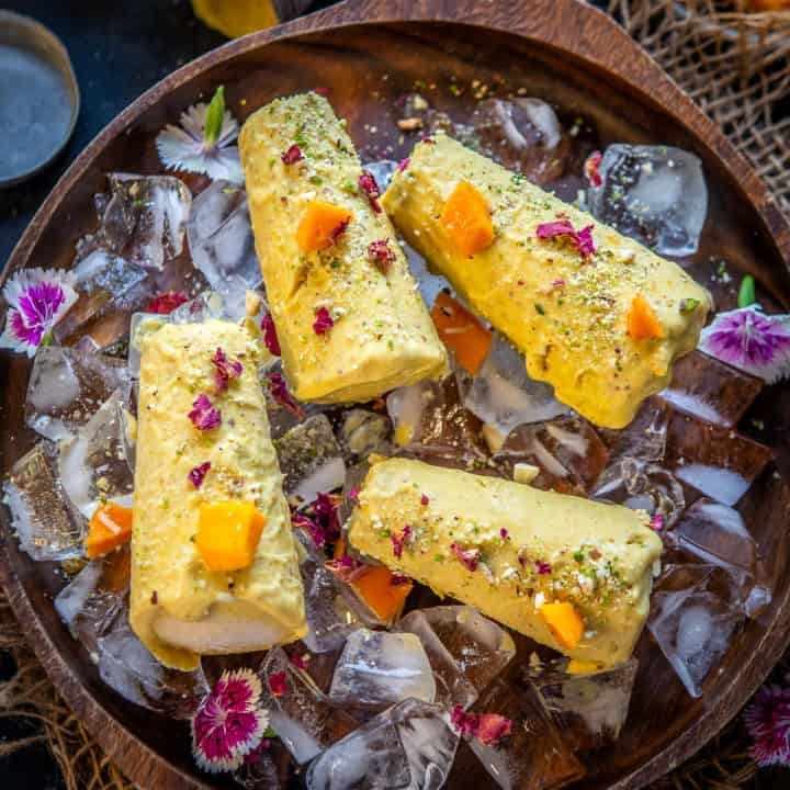 Made using mango puree, condensed milk, kesar, and full cream milk, Mango Kulfi is a delight for the taste buds. Here is a simple recipe of how to make it at home.