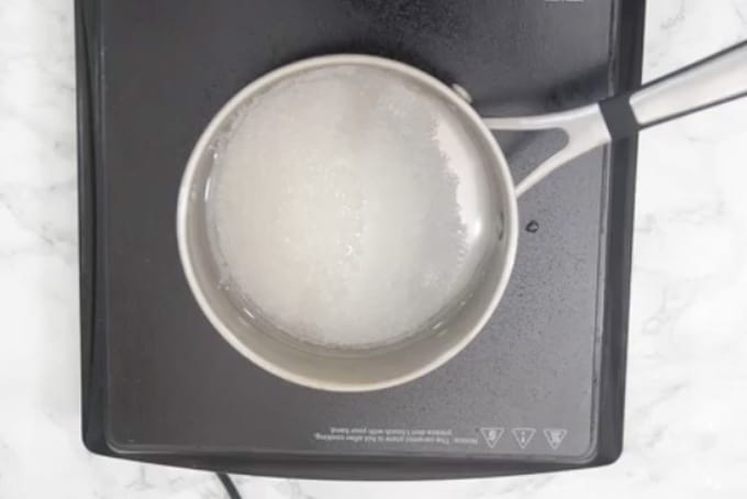 Water and sugar in a pan.