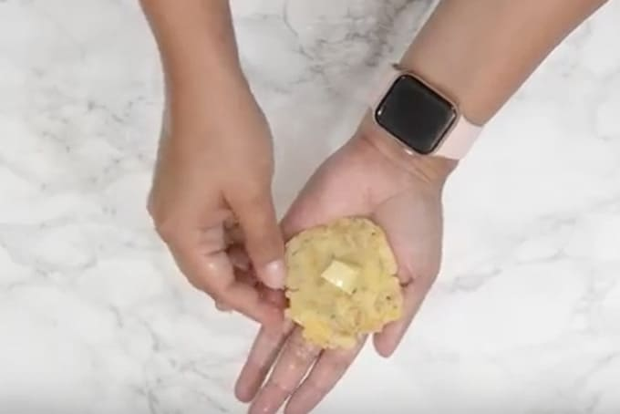 Mozzarella cube kept in the centre of the potato mixture.