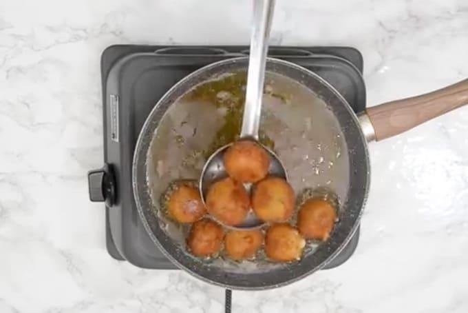 Fried potato cheese balls.