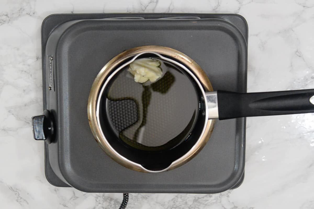 Butter and olive oil heating in a pan.