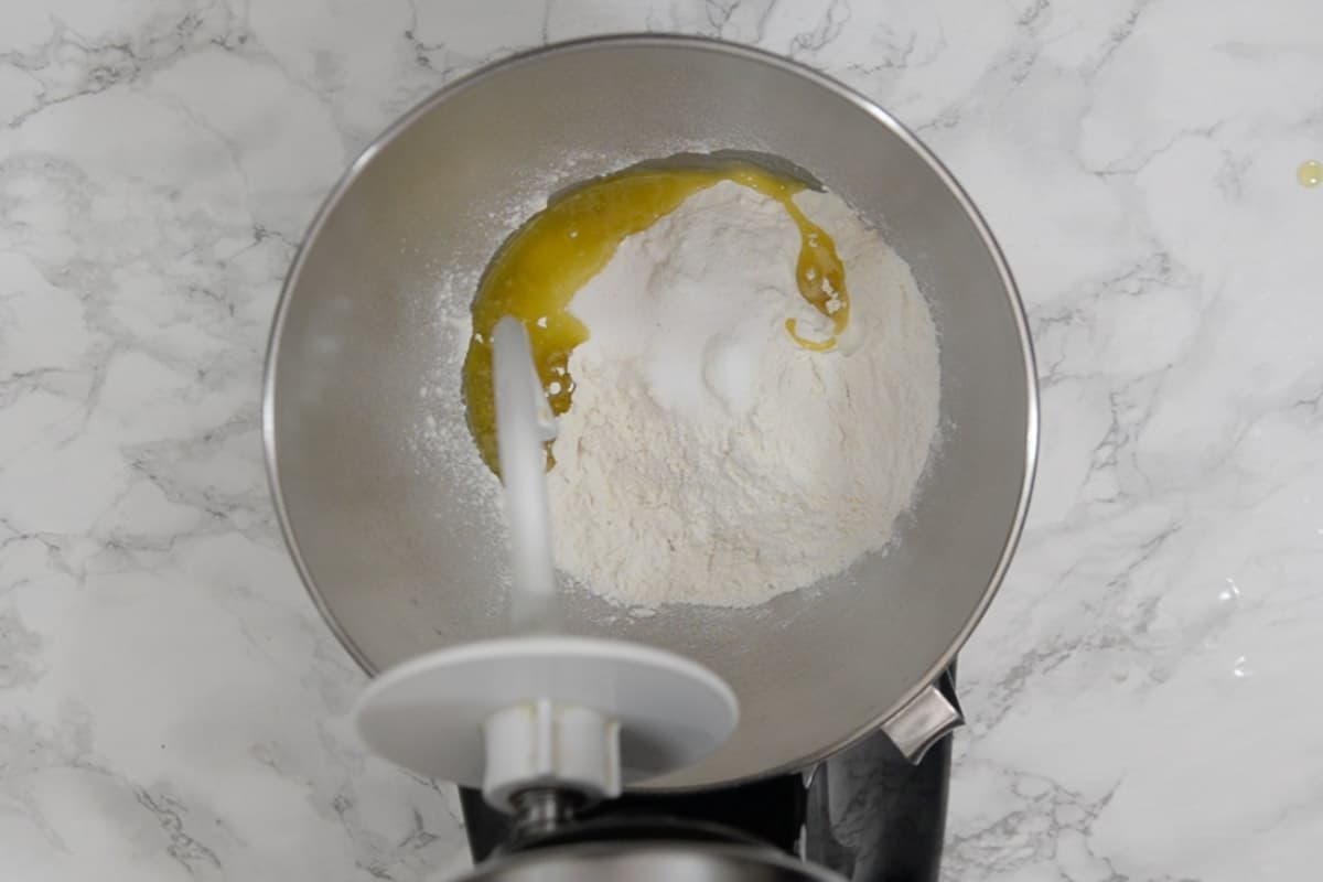 Flour, salt, garlic powder and olive oil mixed in a bowl.