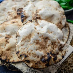 Khamiri Roti, a traditional Indian bread that was a staple in the Mughal era. It is made with whole wheat flour, yeast and milk and is extremely soft and spongy. Do try this one for your festive meals. Here is how to make Khamiri Roti Recipe.
