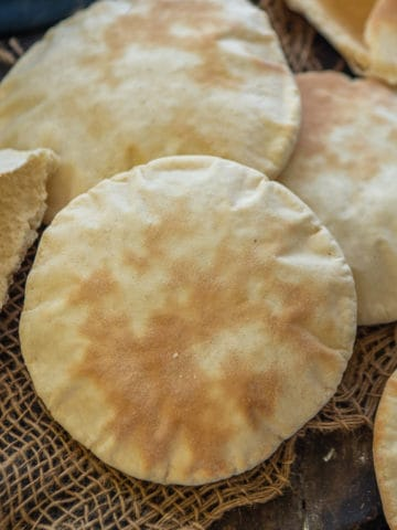 Pita Bread is a Middle Eastern leavened bread which is easy to make at home from scratch. Here is how to make it.