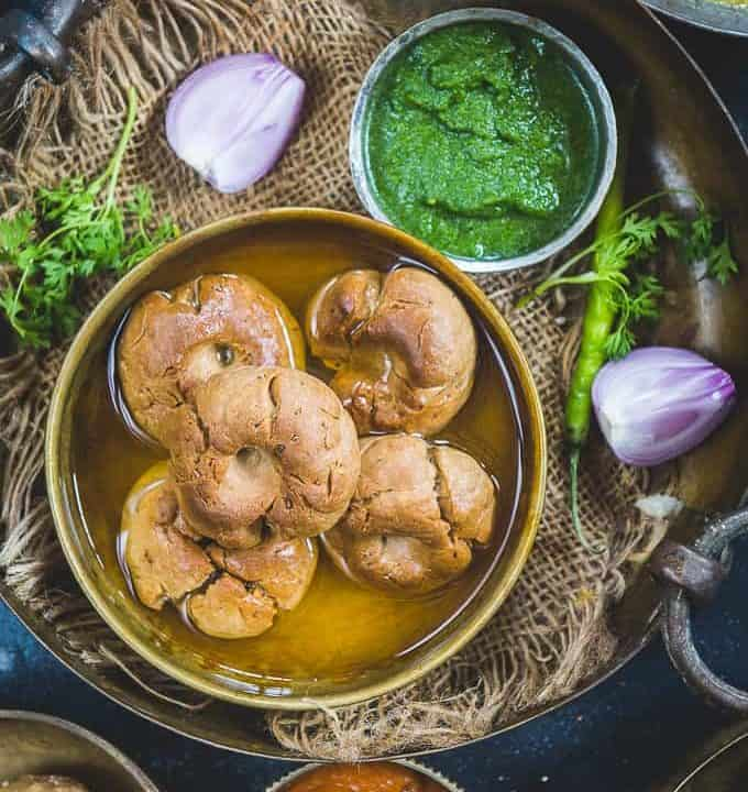Bati served ina bowl along with dal and chutney.