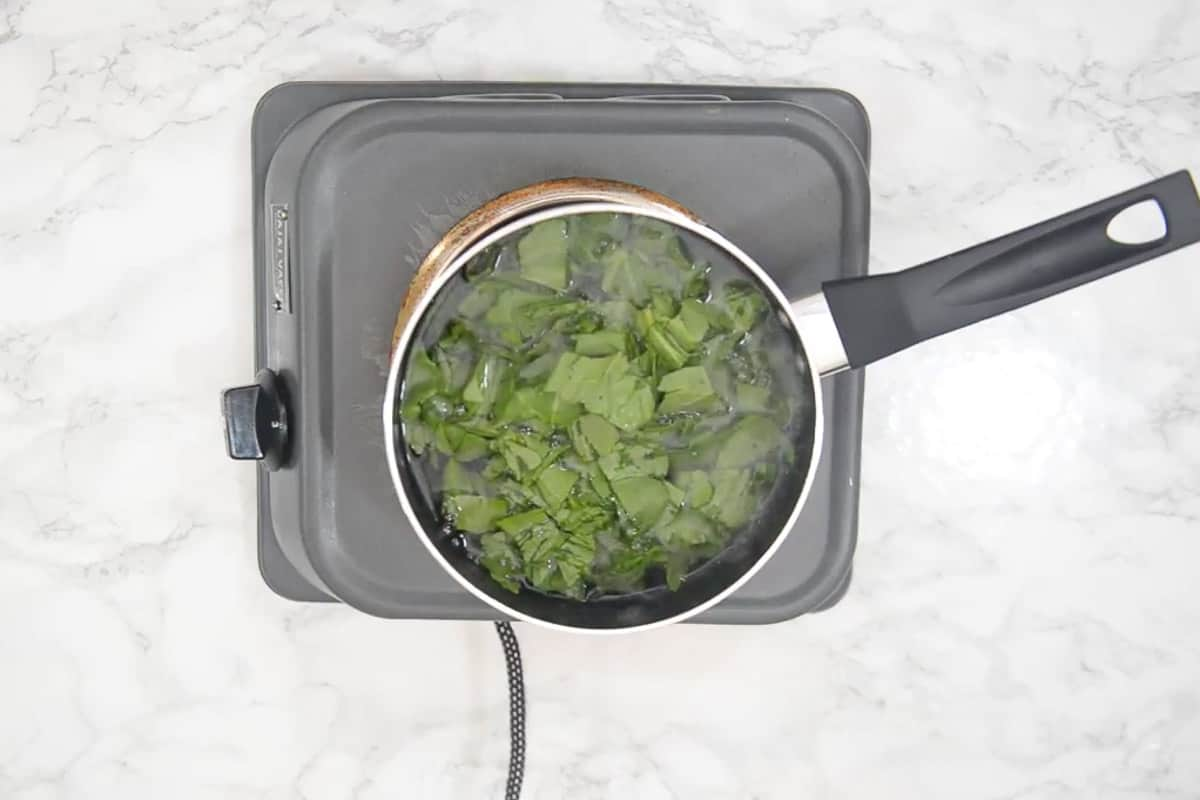 Spinach added in boiling water.