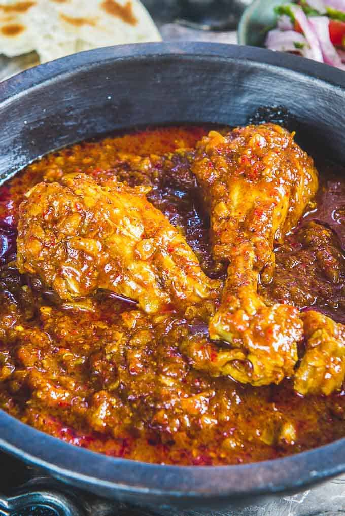Authentic goan chicken vindaloo goan chicken curry whiskaffair close up shot of chicken vindaloo served in a serving bowl forumfinder Image collections