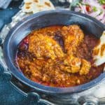 Chicken Vindaloo is a traditional Goan dish with a fiery red color and a slight tang from vinegar. It piars very well with rice or any Indian bread.