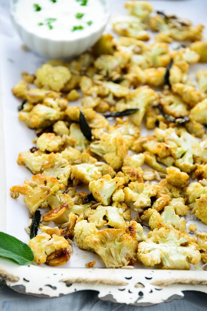 Honey roasted cauliflower with sage and sunflower seeds is a healthy and delicious option for snacks. Here is a tried and tested recipe to make it.