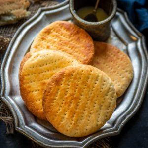 Bakarkhani is a tandoori bread from Mughlai cuisine which is still popular in some parts of Old Delhi. Served with spicy mutton and chicken gravies, this shahi roti is a treat to the tastebuds. Here is how to bakarkhani recipe.