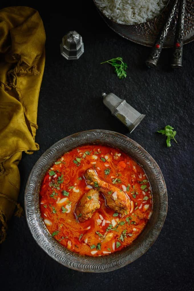 Mughlai Zafrani Chicken is a rich Chicken curry cooked with cashewnut paste and spices and flavored with saffron. Here is a traditional recipe to make it.