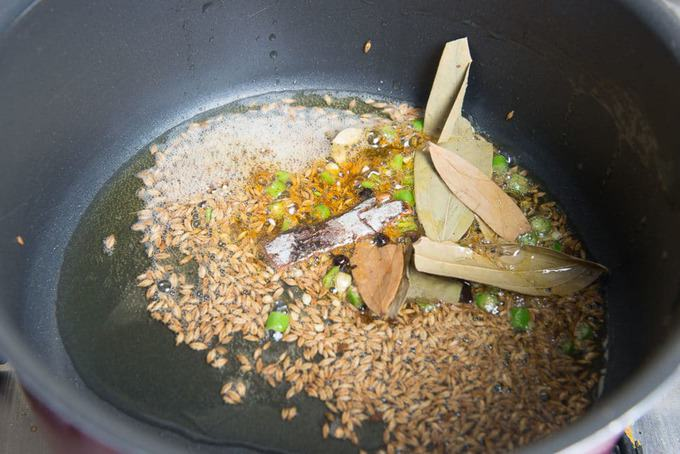 cardamom, cloves, peppercorns and cinnamon added in the pan