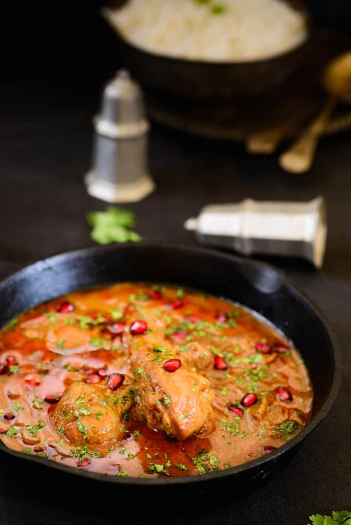 Walnut Pomegranate Chicken is a popular Middle Eastern Chicken dish where Chicken is cooked in a gravy flavored with walnuts and pomegranate molasses.
