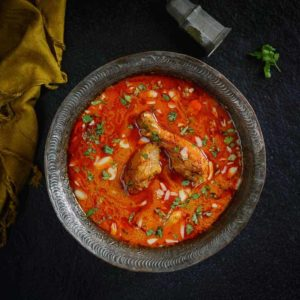 Mughlai Zaafrani Murgh is a rich Chicken curry cooked with cashewnut paste and spices and flavored with saffron.
