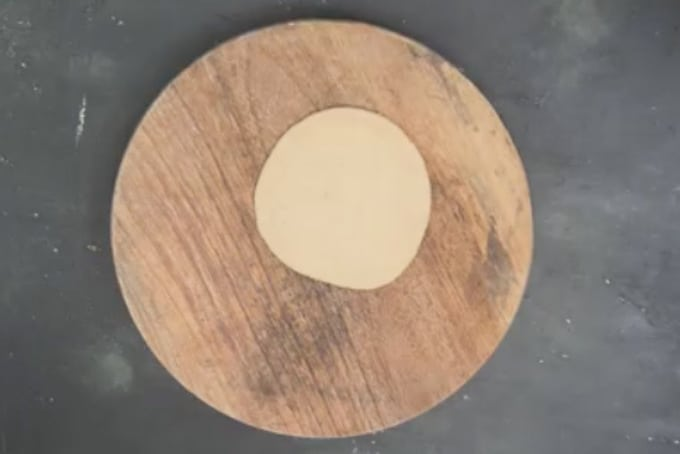 Ball rolled into a 4 inch circle.