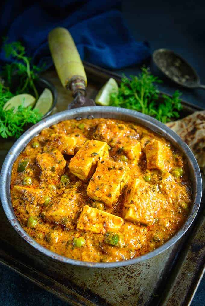 Achari paneer served in a bowl.
