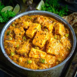 Achari Paneer is an Indian cottage cheese curry made using pickling spices. Slightly tangy and full of flavors, this curry goes perfect with Indian breads.