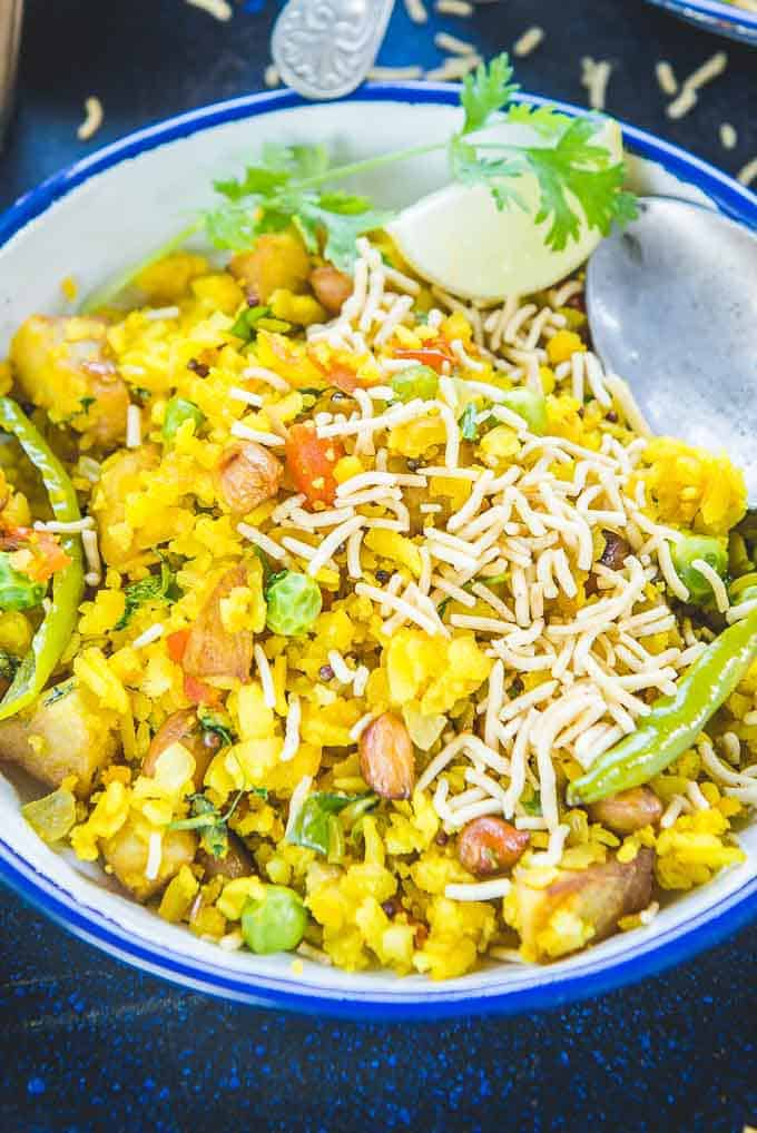 Close up shot of aloo poha served in a bowl