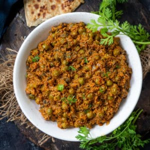 Mushroom Matar is a delicious Indian curry made using fresh mushrooms and green peas. It pairs well with any Indian bread. Here is how to make it.
