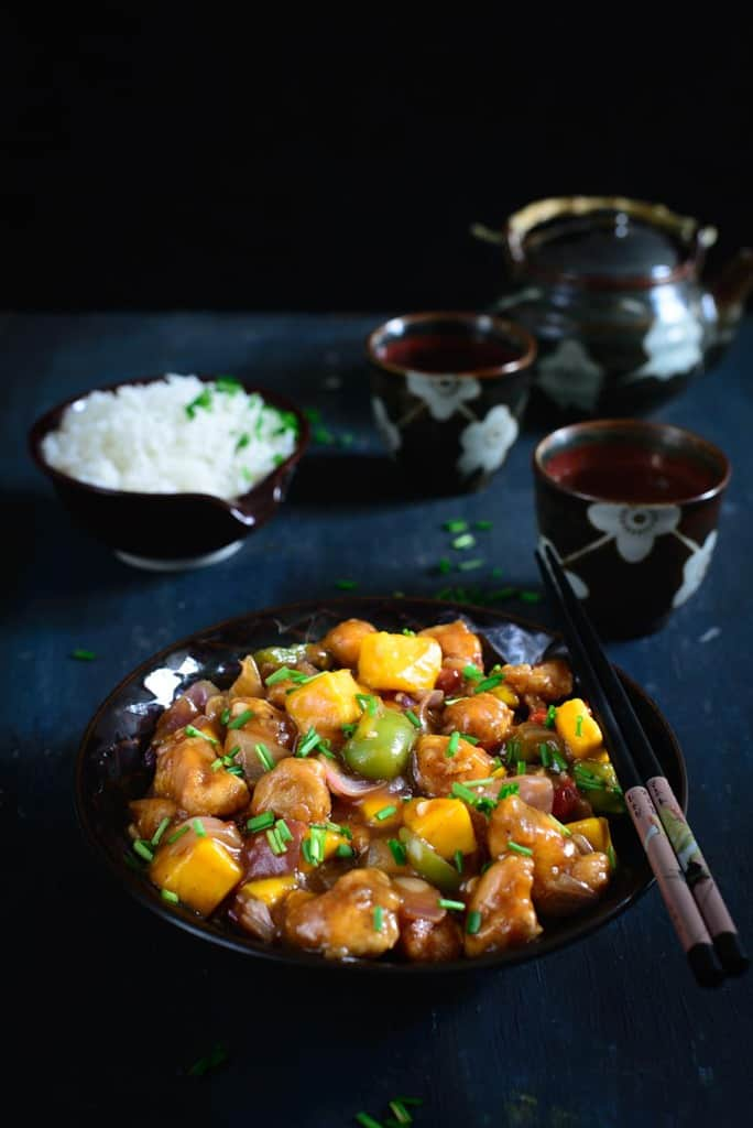 Asian Mango Chicken is a delicious Chinese style chicken gravy with a twist of mango. Enjoy this different recipe with noodles and fried rice!