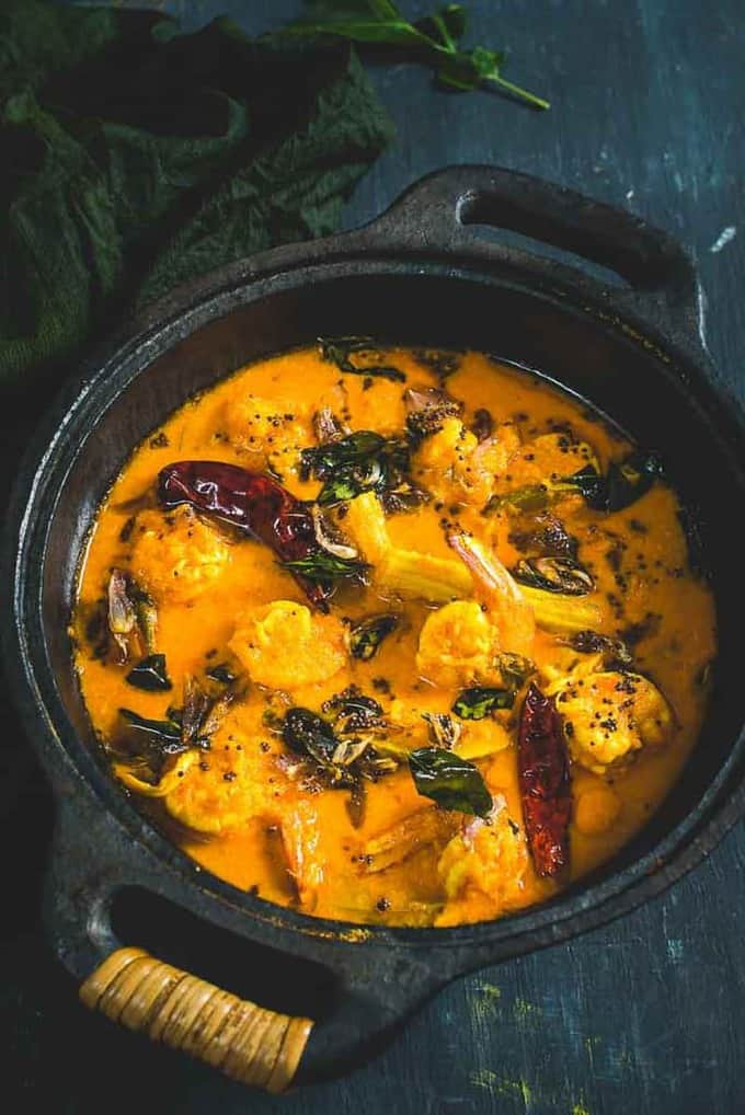 Kerala Style Raw Mango Prawns Curry is a prawn curry made using freshly ground coconut, raw mangoes, drumsticks.It tastes well with steamed rice or Appam.