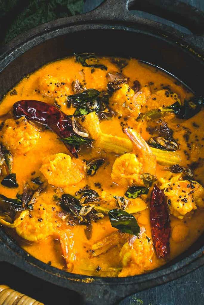 Kerala Drumstick Raw Mango Prawns is a prawn curry made using freshly ground coconut, raw mangoes, drumsticks.It tastes well with steamed rice or Appam.