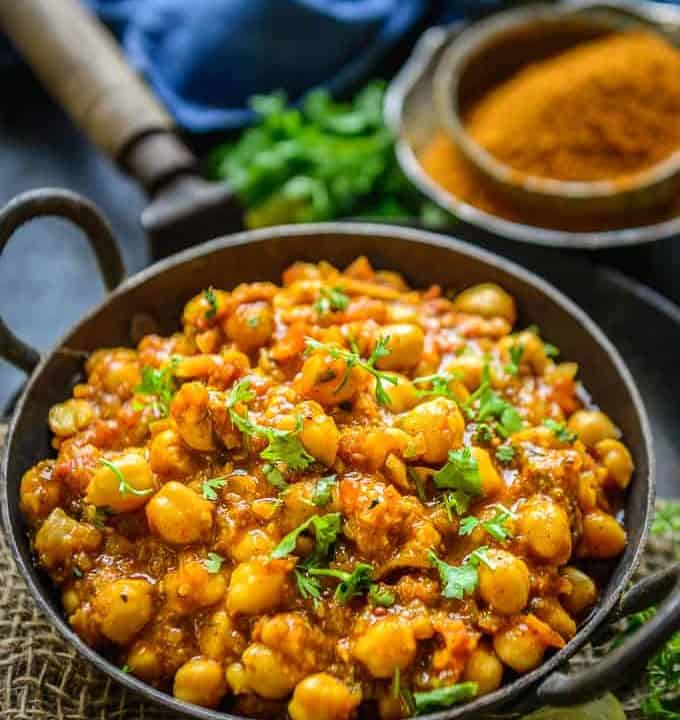 Achari chole served in a bowl.
