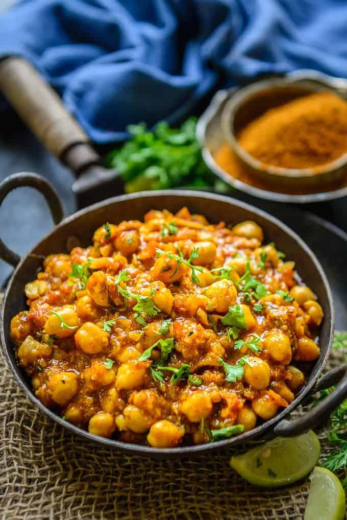 Achari chole served in a bowl.