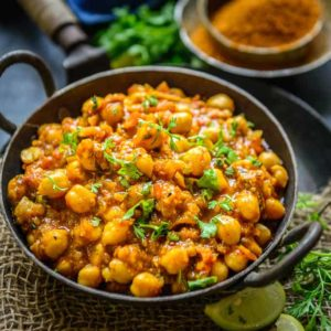 Achari chole is a delicious Chickpea curry made using Indian pickling spices. Here is a simple and easy to make recipe to make Achari chole.