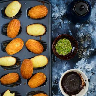 Lemon and Vanilla Madeleines with Chocolate and Pistachios
