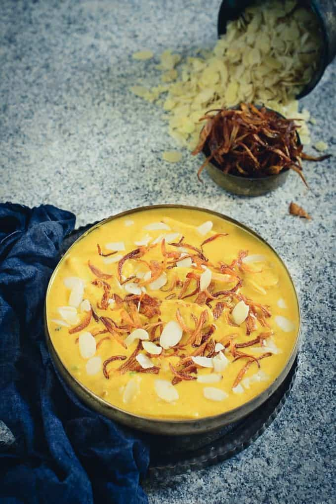 Mughlai Dum Arbi is a Mughlai Style Vegetarian curry made using taro Roots. The gravy is rich and creamy with the use of nuts and spices.