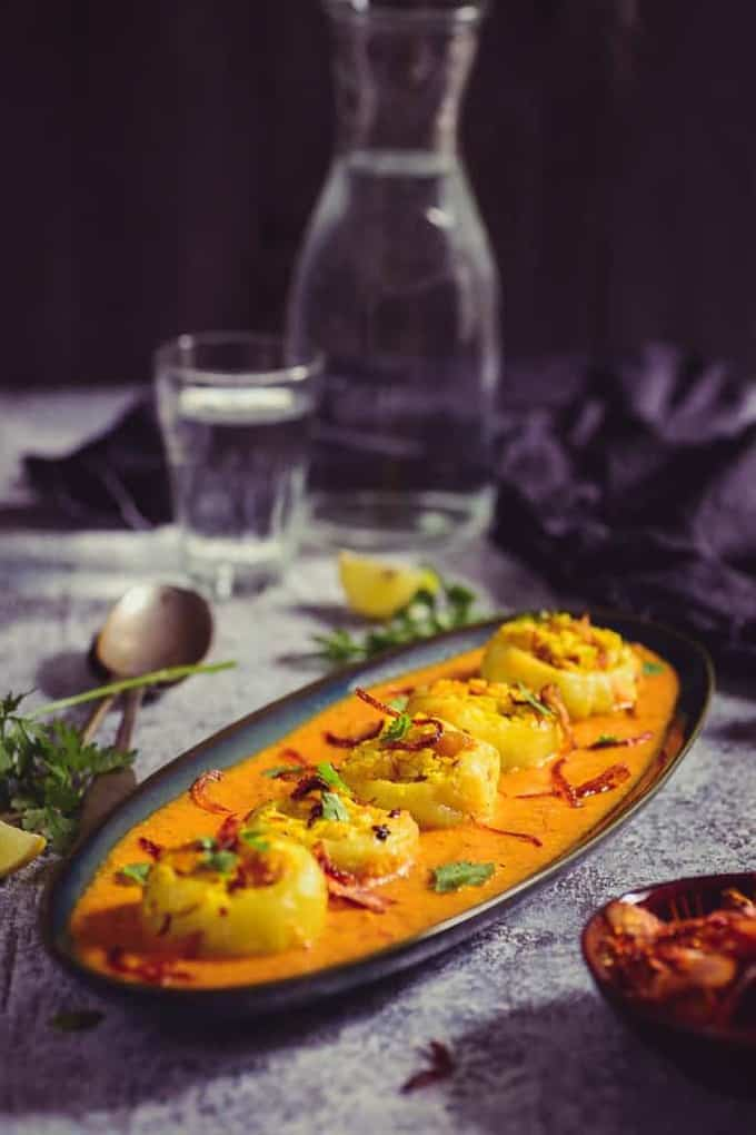 Shahi Bharwan Tinde is a royal recipe where tinde are stuffed with paneer and nuts and then served with a rich and creamy gravy.