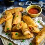 Spring rolls is a classic Indo Chinese dish perfect for evening snacks or entertaining guests. Use this simple Spring Roll Recipe and make these at home.