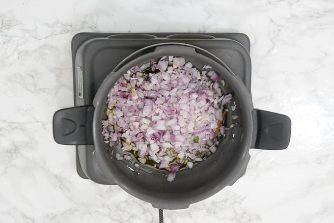 Onion added in the cooker.