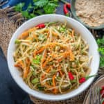 This traditional Thai Green Papaya Salad or Som Tam is a crunchy salad made using green raw papaya as the hero ingredient. It's easy to make, gluten free and can be made vegan by skipping fish sauce.