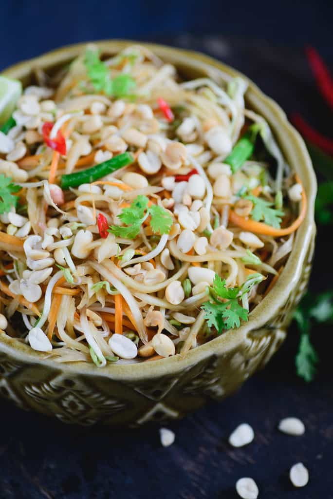 Spicy Thai Green Papaya Salad is a healthy and delicious authentic thai style salad made with raw papaya with Thai flavours.