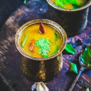 Kerala Style Rasam or Thakali ( Tomato ) Rasam is made using freshly ground spice mix and can be eaten with rice or as a drink.