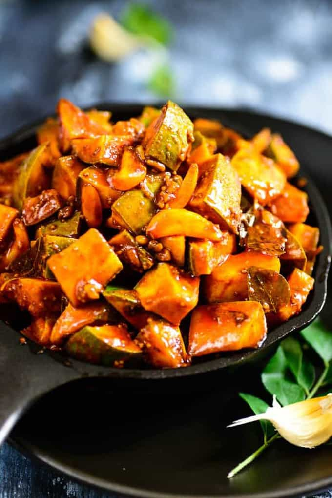 Kerala Style Instant Mango Pickle is a tangy pickle which can be made in no time and is ready to be consumed as soon as it's done. Read its recipe!