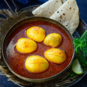 Kolhapuri Egg Curry or Anda Rassa is a spicy curry made with eggs and some special Kolhapuri spices. This dish is spicy and can be paired with roti or rice. Here is how to make Anda Rassa or Kolhapuri Egg Curry Recipe.