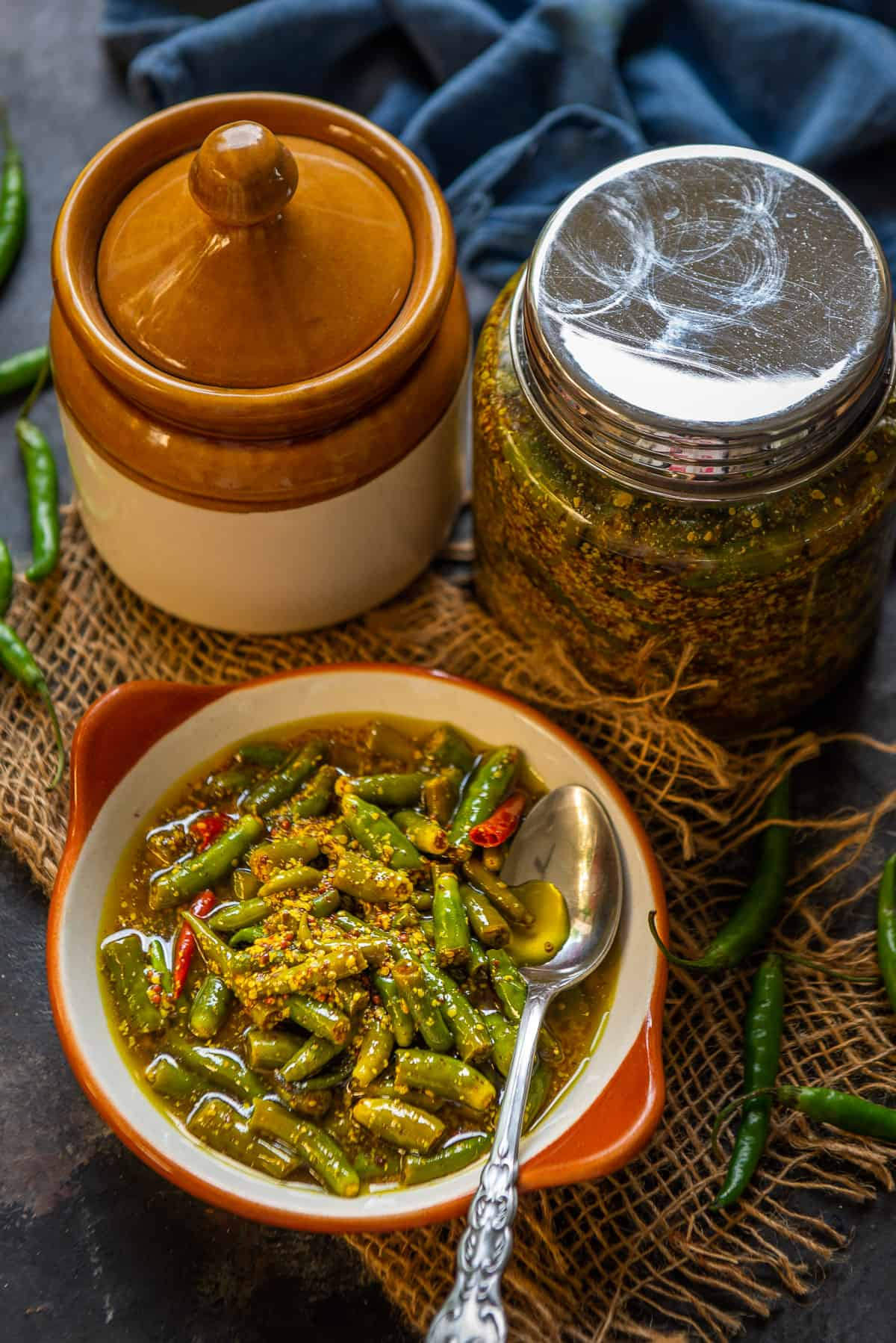 Green chilli pickle served in a bowl.