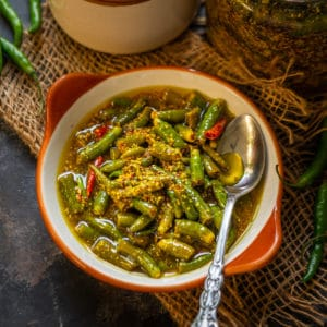 Hari Mirch Ka Achar or Green Chilli Pickle  is a delicious North Indian style pickle recipe where fresh green chillies are pickled with mustard seeds and lemon juice. This pickle goes very well with any Indian meals. Here is my mother's recipe of how to make it.