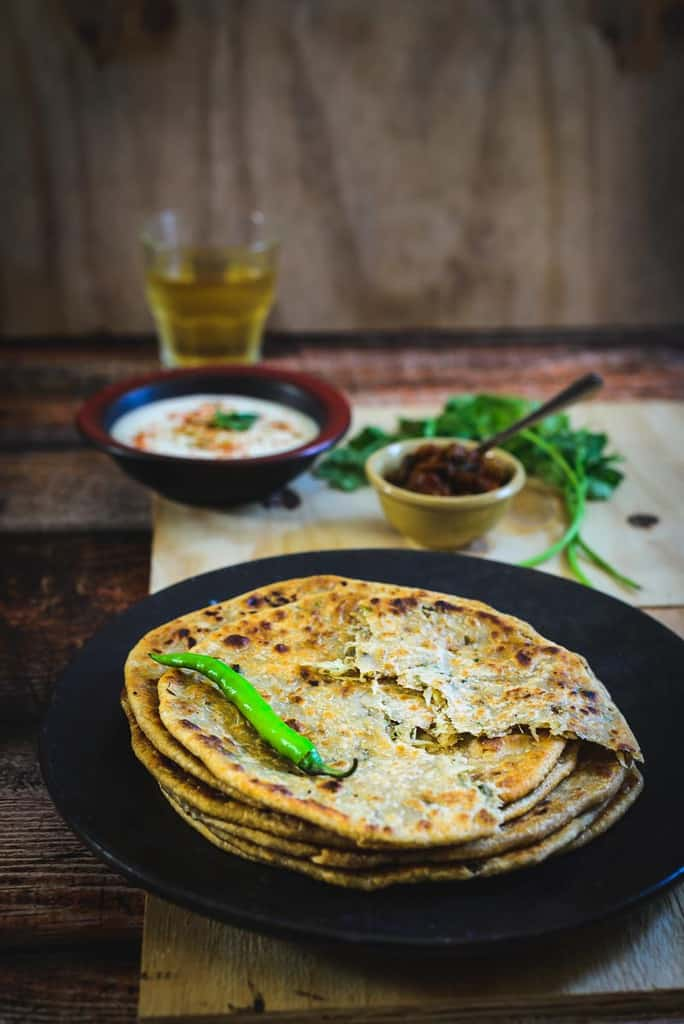 Kacche Papite Ka Paratha is a healthy accompaniment to curries, that uses the papaya vegetable in its raw form with all its nutrients intact.