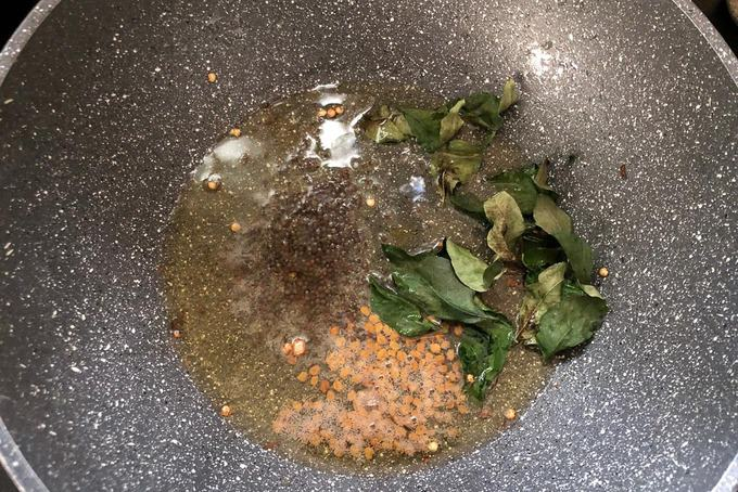 Mustard seeds, fenugreek seeds and curry leaves added in the pan.