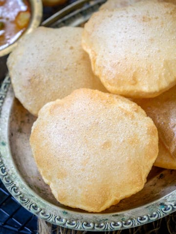Want to learn to make perfectly puffed up poori? My recipe with tell you tips and tricks to make the perfect golden soft and puffed Puri at home.