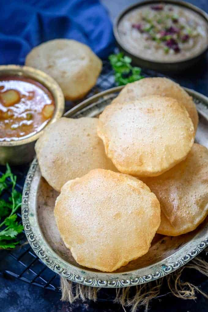 Poori served on a plate.