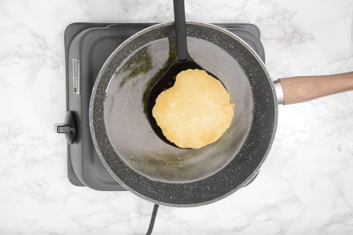 Poori fried in hot oil.