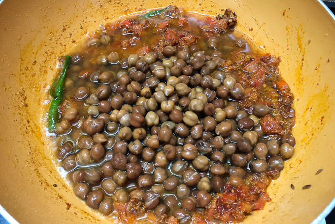 Chana added in the pan.
