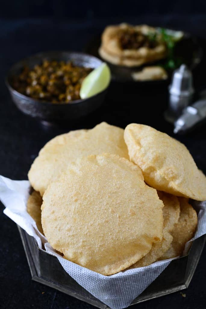 Tips and tricks on how to make perfect poori, a deep-fried puffed Indian bread, every time you make it with step by step instructions.